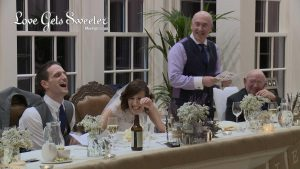 father of the bride speech makes the bride and groom laugh during speeches at Mitton Hall in Clitheroe for their wedding video