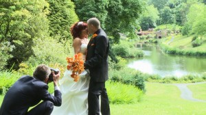 claire and justin posing for their wedding photographer and videographer at consall hall gardens in staffordshire
