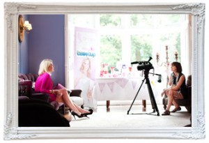 charlene from Love Gets Sweeter sits across from Julia from Brides Up North as she interviews her on camera to talk about her wedding blog and the wedding supplier event held at Didsbury house near Manchester