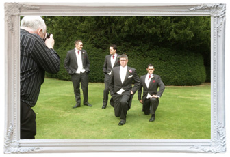 mick cookson their wedding photographer captures a fun moment of the groomsmen messing around doing lunges during the wedding at Mottram hall for the wedding video