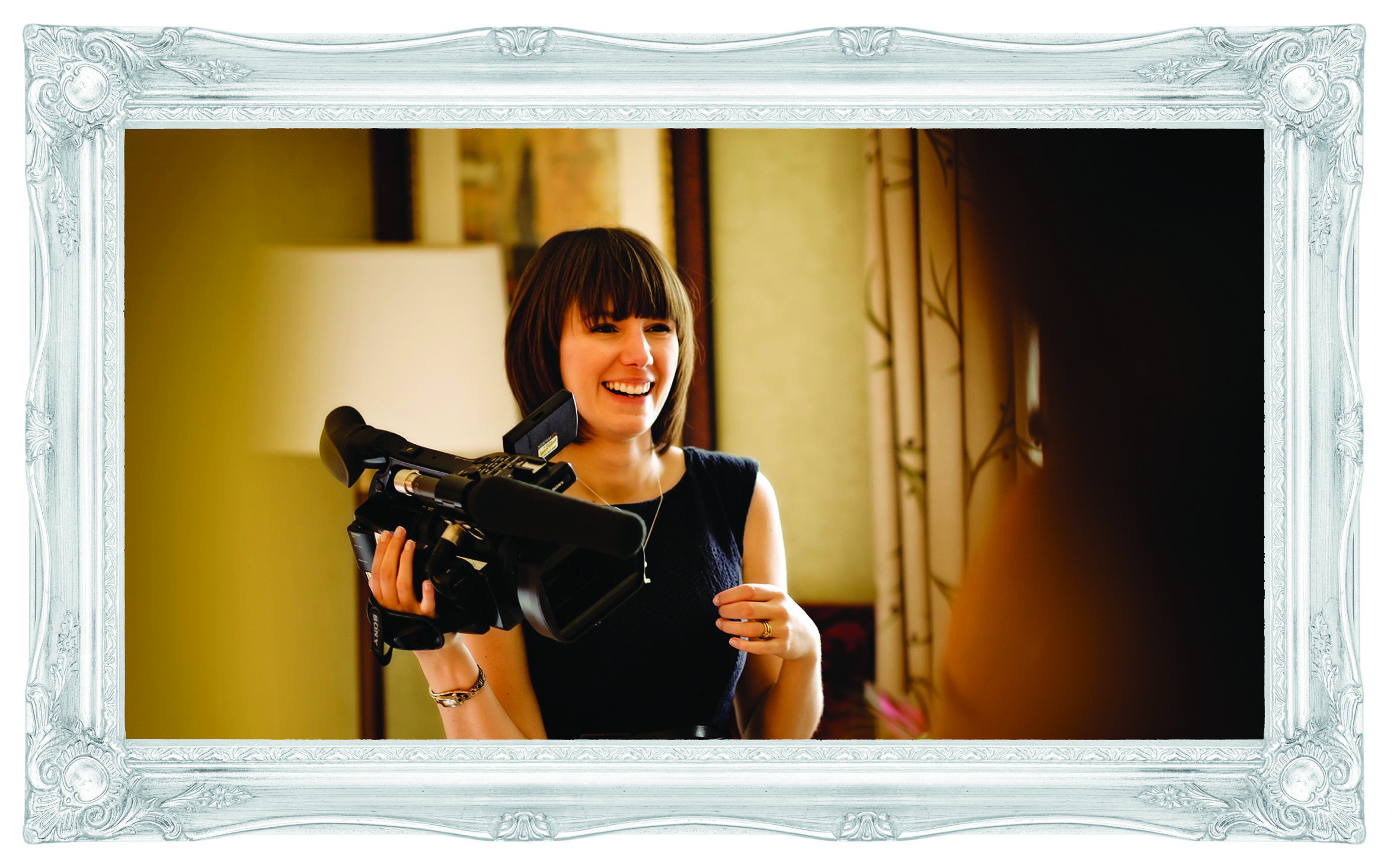 female videographer at love gets sweeter wedding films laughing with the bride on the morning of the wedding at mottram hall