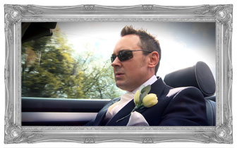 Groom wearing sunglasses and looking all cool driving wedding car Audi S4 for his own wedding video by love gets sweeter