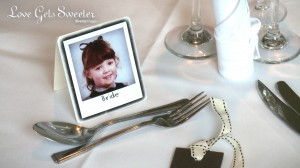 fun table place cards of childhood photos. This one is of the bride in primary school sat at the top table during their lake district wedding
