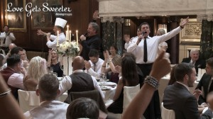 A wedding video still of The singing waiters from Encore entertainment perform as a surprise for both the bride and the wedding guests at this Thornton Manor wedding