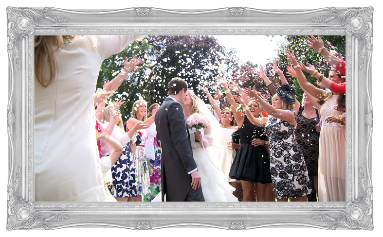 a still from the wedding video of the Bride and Groom bright pink confetti shot Deanwater Hotel Manchester Stockport Cheshire wedding