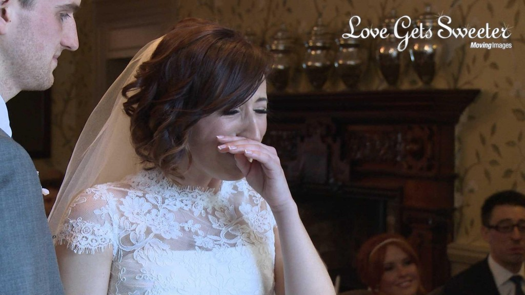 Keri the bride fights back the tears after a surprise during her wedding ceremony and it's caught on wedding video by love gets sweeter wedding videographer