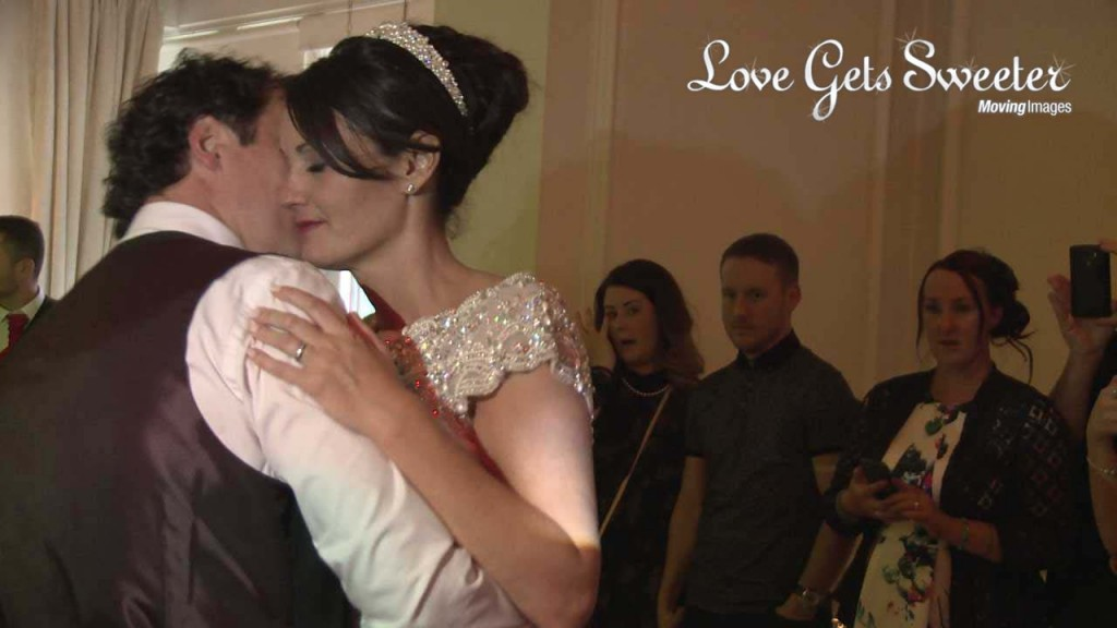 A romantic first dance at the west tower is filmed by their wedding videographer Love Gets Sweeter. She leans against her groom with her eyes closed