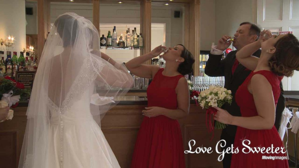 a wedding video still of the bride and her bridesmaids do a shot of whiskey at West Tower before they leave for the church in Lancashire
