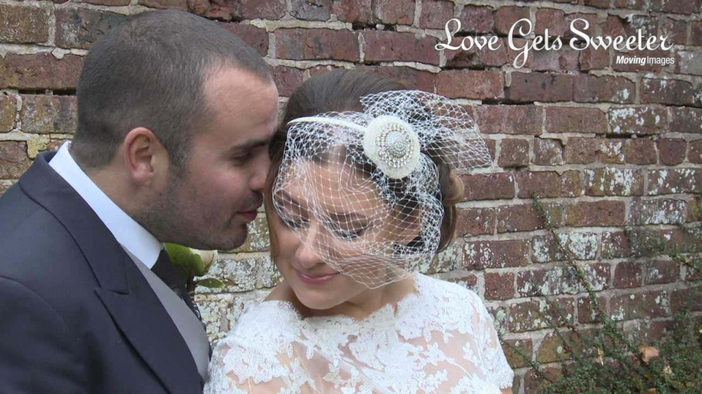 a wedding still showing off Rebecca's incredible vintage birdcage veil she wore on her wedding day at Soughton Hall