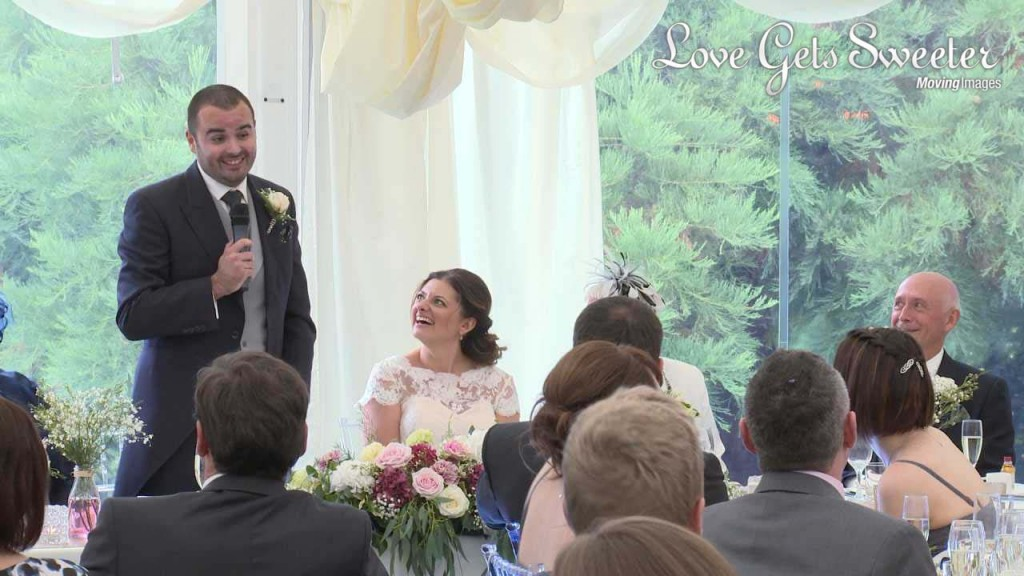 groom delivering funny speech in marquee at Soughton Hall