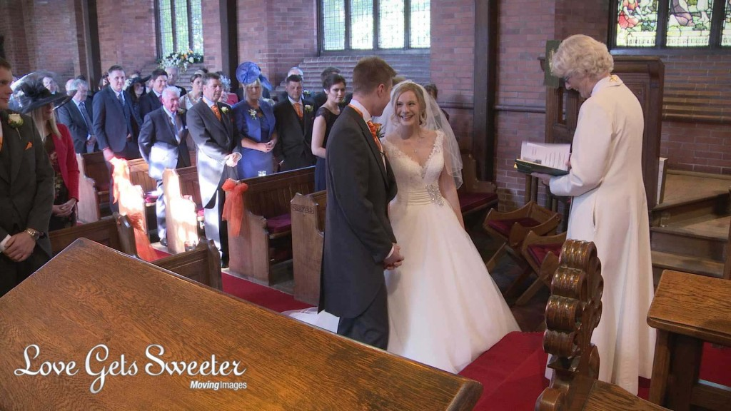 the wedding videographer love gets sweeter films the first look as the bride meets the groom at St Johns Church in High Legh Cheshire