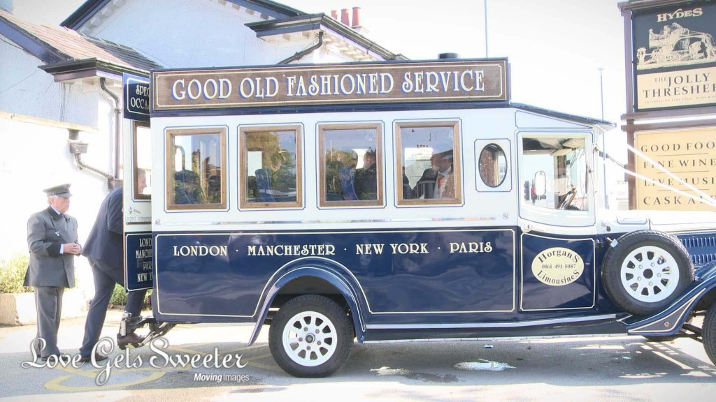Alistair and his groomsmen climb in to the back of their traditional blue and cream hired Horgans wedding bus before heading to the church in High Legh Cheshire