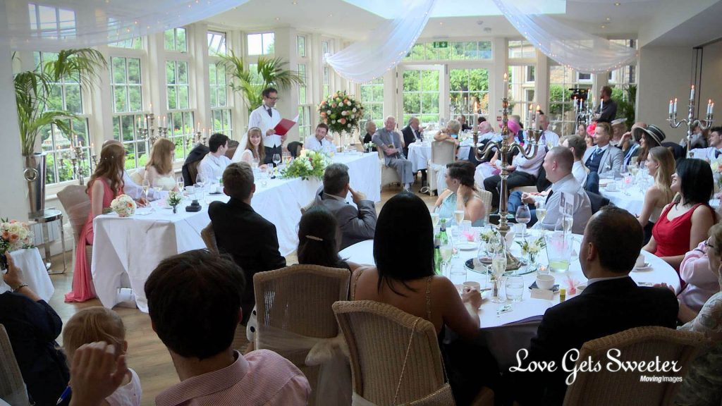 mitton hall wedding venue in clitheroe lancashire white and light reception room filled with guests listening to the father of the bride make his speech