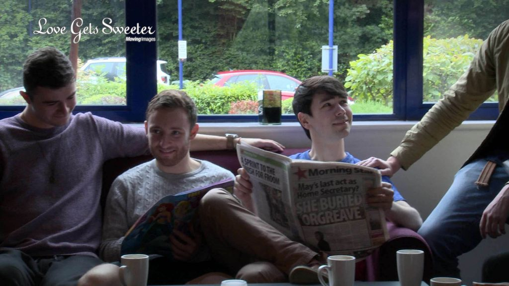 A frame taken from the wedding video showing the Groom, his Best man and ushers enjoying a coffee and reading the morning paper before the wedding at St Johns Church in Broughton near Preston