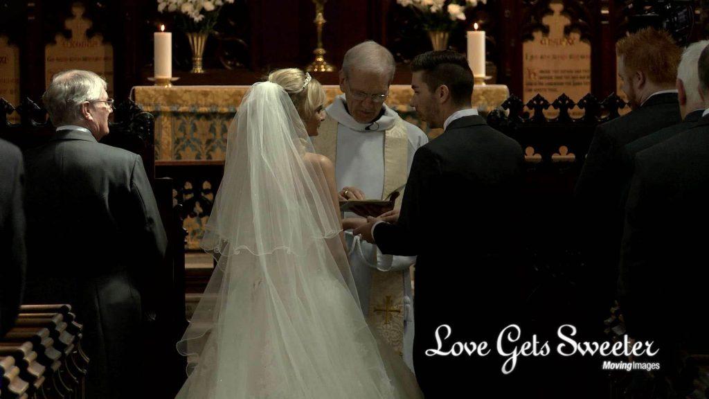 bride and groom exchanging wedding rings filmed by Love Gets Sweeter wedding films