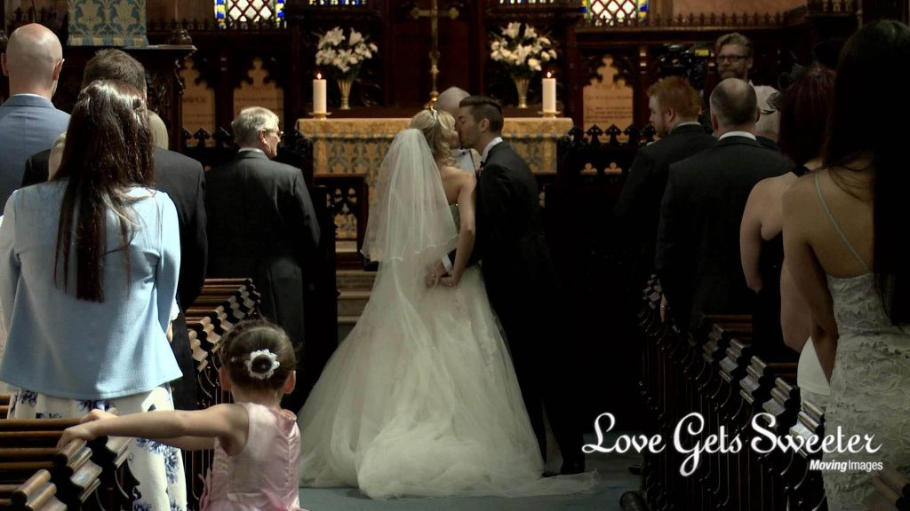 bride and groom sealing it with a kiss at St Marys Sandbach