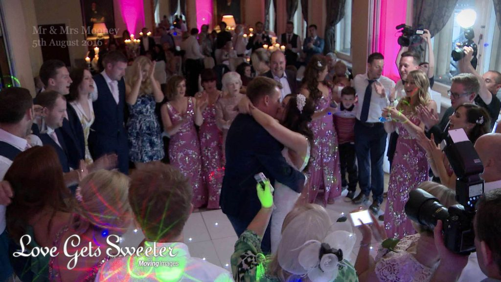 bride and groom kiss during dance filmed by love gets sweeter at racquet club