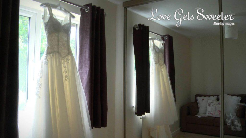 bespoke wedding dress hanging up at brides house in Ewloe