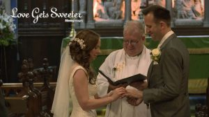 bride putting ring on groom and exchanging wedding vows during their church service in Cheshire