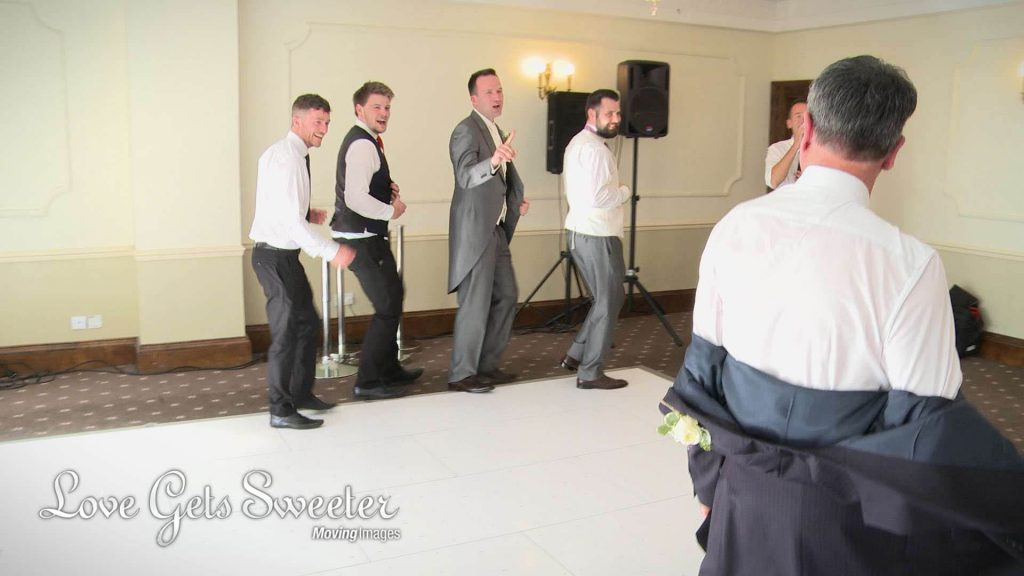 groom and friends dancing in their own boyband during singing waiters surprise perfomance at Willington Hall