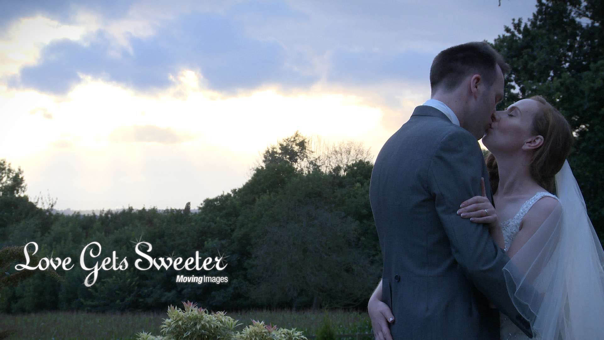romantic bride and groom shot staged for wedding video during sunset at summer wedding