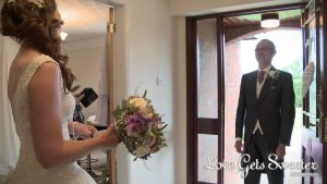 dad sees daughter for first time as a bride in her wedding dress