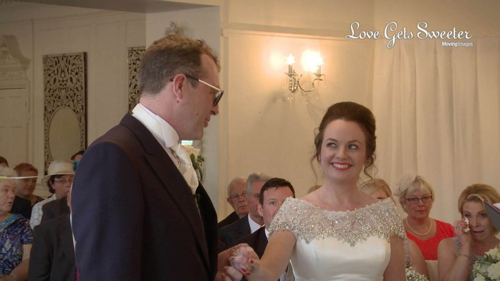 happy bride and groom during wedding ceremony at Eaves Hall