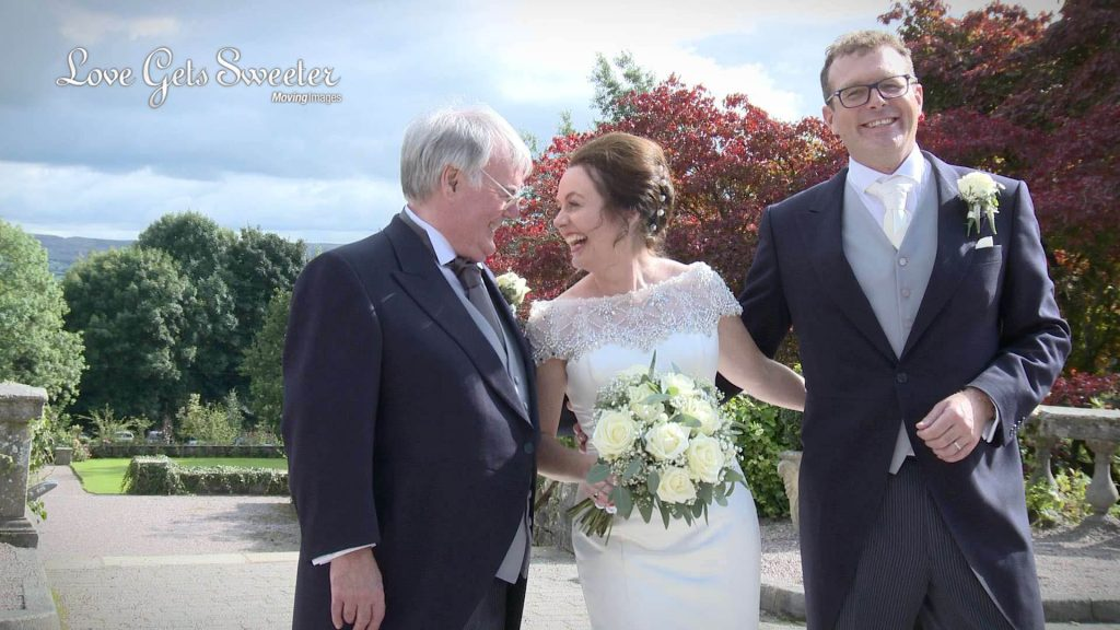 formal wedding photographs with father of the bride and laughing for video