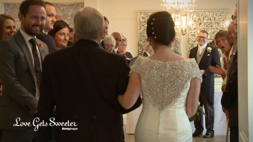 wedding video of bride walking down aisle at Eaves Hall