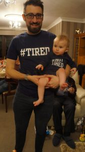 daddy and baby girl with tired and not tired tshirts on at christmas in Burscough
