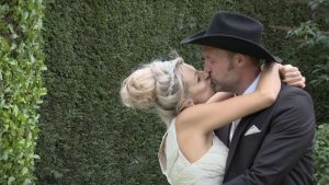 bride and groom have a big kiss during their farm wedding before their wedding photographs in drighlington