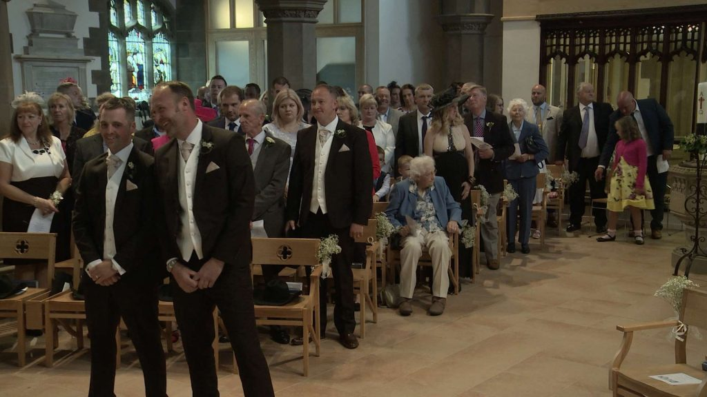 Groom and guests waiting for the bride at St Pauls church in drighlington for the wedding video