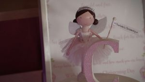cute fairy topper on a christening cake at Rhyl Golf course