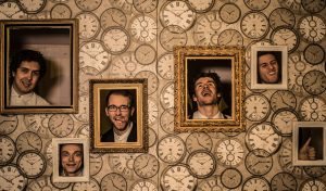 wedding band wandering wings on a promo shoot for their music agency pulling faces with their heads in picture frames
