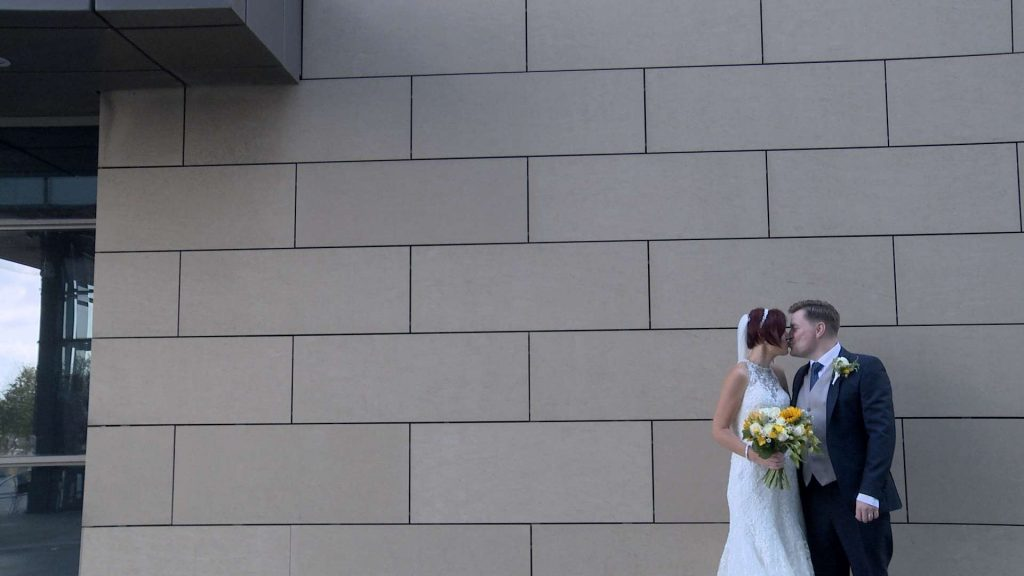 The Bride and groom have a kiss outside media city after being married