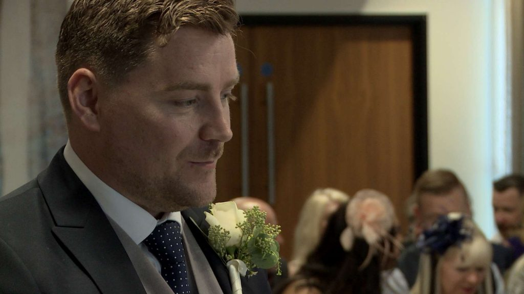 A smile creeps on to the grooms face as he nervously waits for the Bride to walk down the aisle at On The 7th