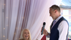 the father of the bride makes his wife laugh during his speech at the Blue Mallard in Burscough lancashire