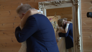 you see a dad hug his bride as he sees her for the first time before her wedding ceremony at Styal Lodge in Cheshire