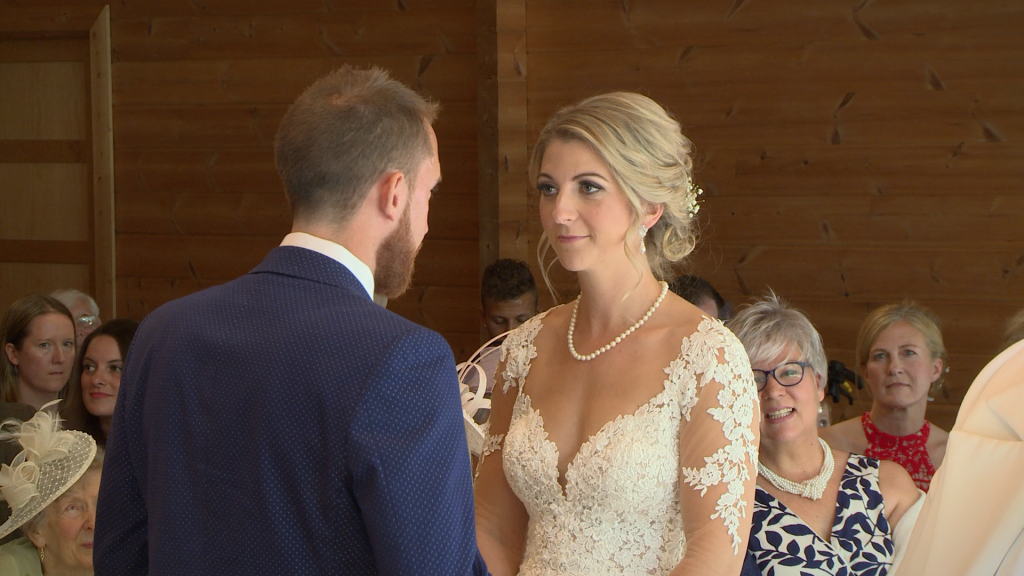 The bride and groom share their personal wedding vows with each other for the wedding video