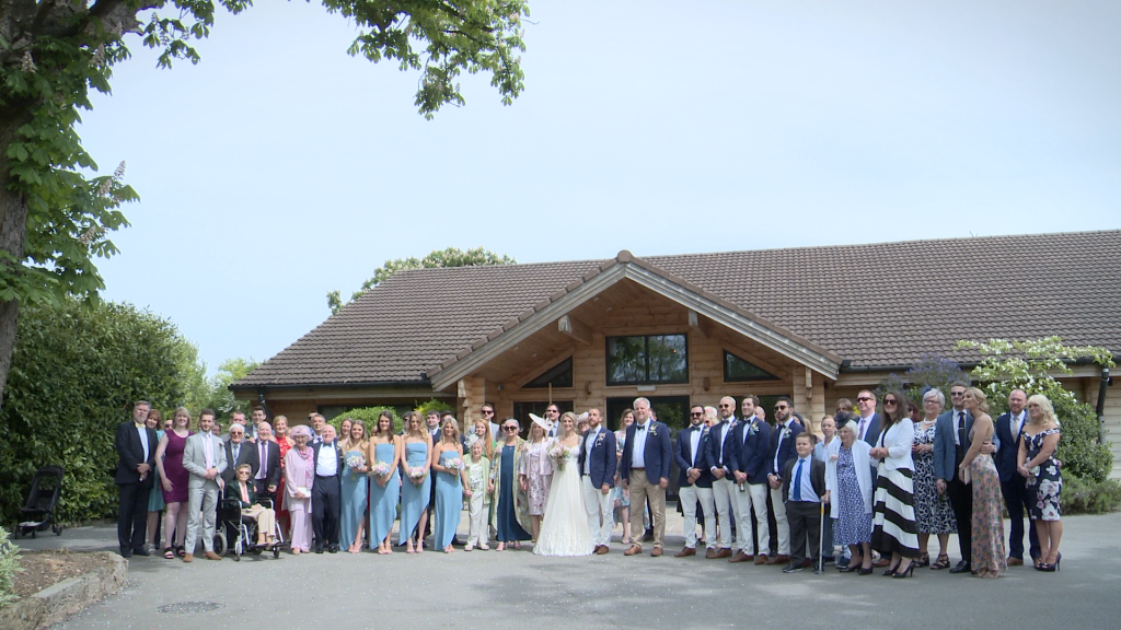 a large group family wedding photo outside Styal Lodge in Cheshire by Daniel Lloyd