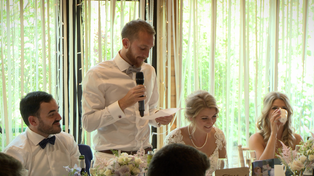 A wedding video still of the groom speaking from the heart about his new wife during their wedding speeches Styal Lodge in Cheshire
