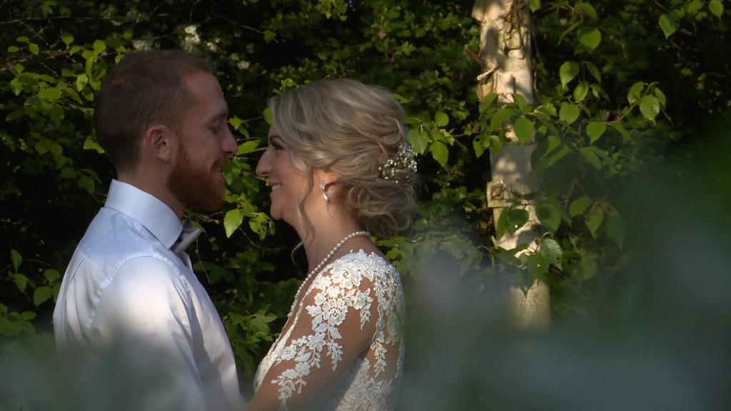 golden hour light shimmers on the brides face as they pose for their wedding photos at Styal Lodge in Cheshire