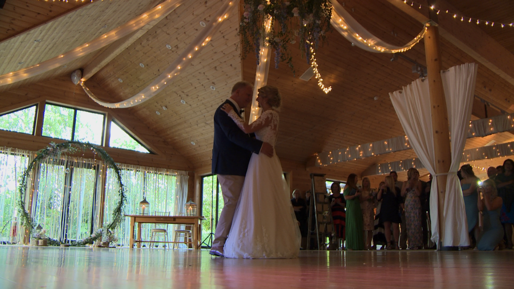 a father and daughter dance at Styal Lodge in Cheshire under fairy lights for the wedding video