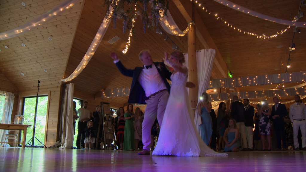 the bride and her dad have fun bumping hips during their father and daughter dance at Styal Lodge in Cheshire