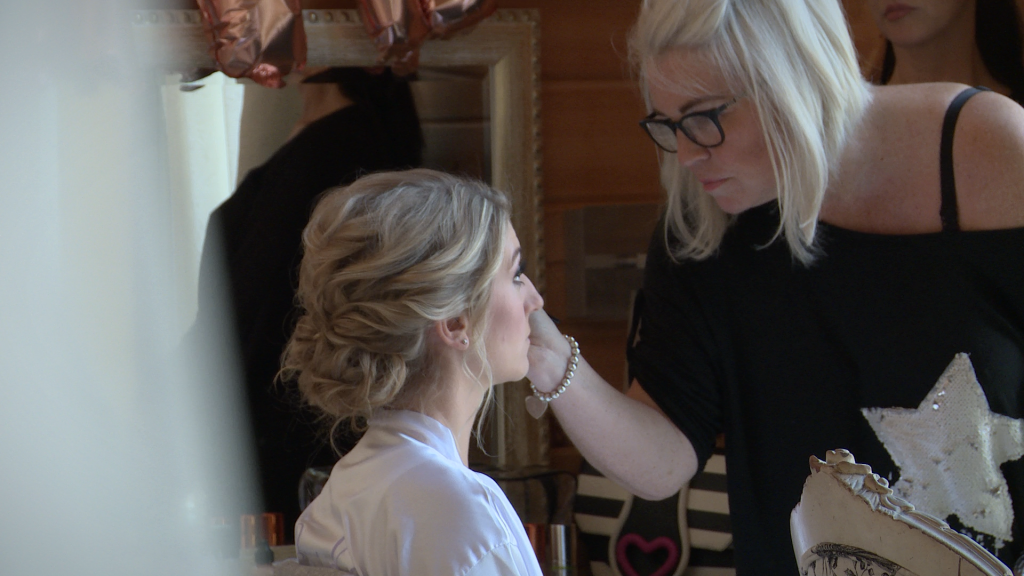 A video still of ruby slippers make up artist working on a Styal lodge bride in Cheshire