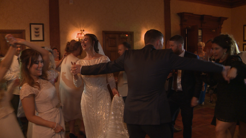 The bride sings out loud as they dance their first dance to sister sledge at their wedding reception at Inglewood manor