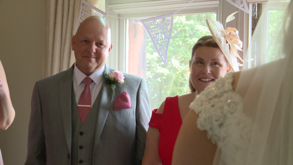 dad fights back the tears as Mum smiles at their daughter now a bride ready to get married