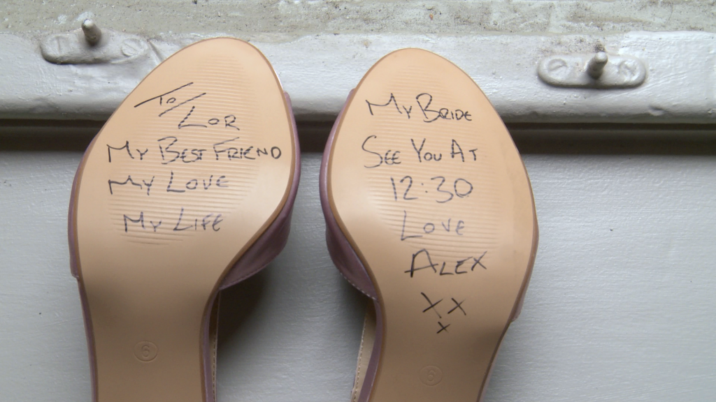 the groom writes a secret message on the bottom of his brides shoe saying to laura my best friend my love my life see you at 12:30 for their wedding at thornton manor