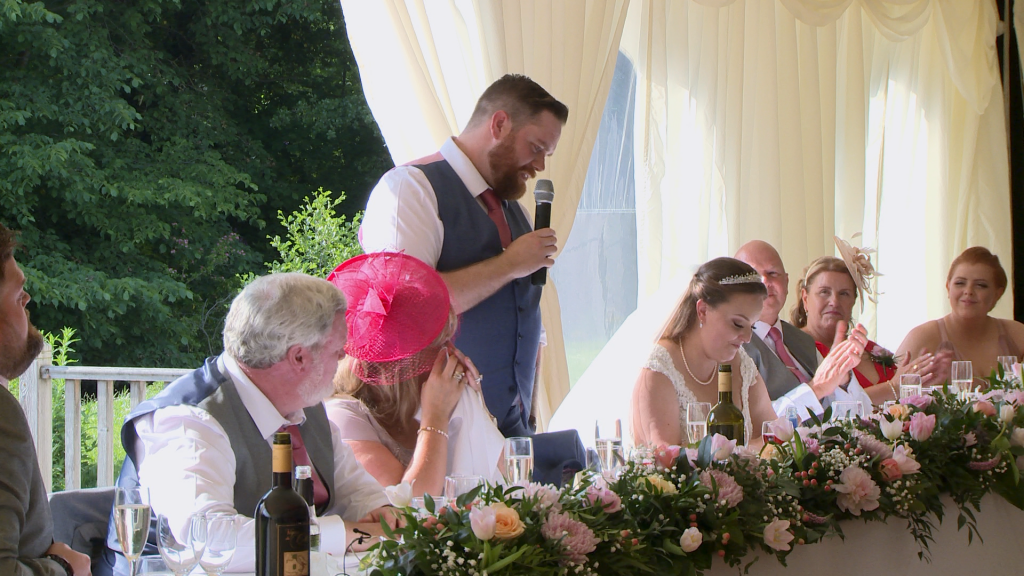 the groom says some lovely things about his new wife during their wedding reception