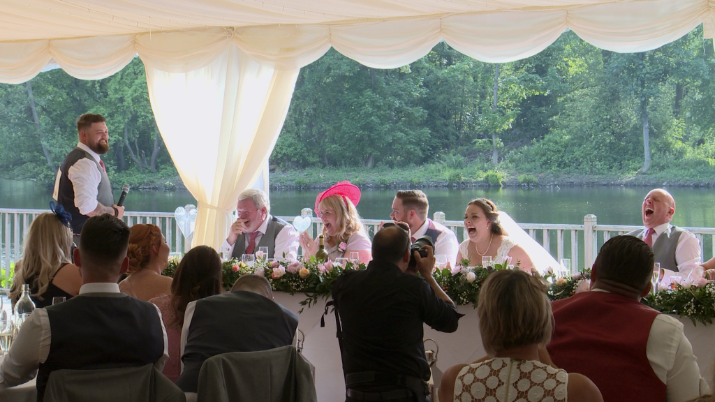 everyone laughs out loud at the sign on the back of the best man to play a joke on the father of the bride about swearing